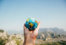 Person holding world in their hand