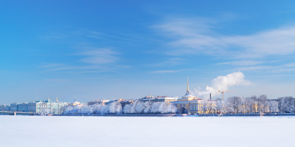 Winter panorama at Saint-Petersburg, Russia. Neva river and palace quay at sunny day
